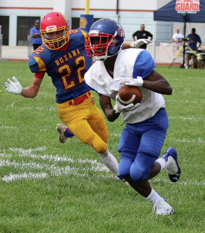 Carlinville's Jahraven Johnson (right) heads up field after getting past Roxana's Austin Wilburn during a season-opening SCC football game Aug. 31 at Raich Field in Roxana. COVID-19 restrictions have prep football in 2020 in jeopardy. Photo: Greg Shashack / The Telegraph