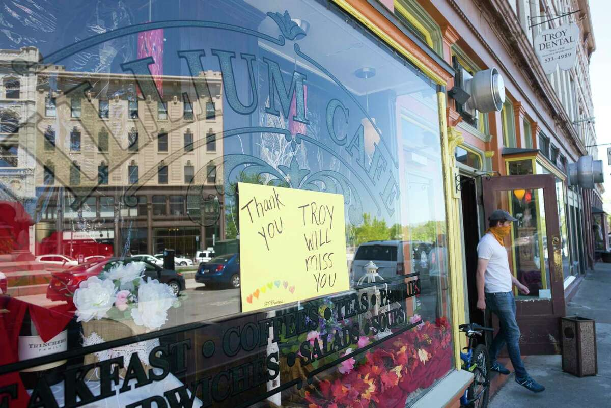 A sign on the front window of the Illium Cafe and Bistro is posted to thank their customers seen here on Wednesday, May 20, 2020, in Troy, N.Y. The owner, chef Marla Ortega, has announced that the restaurant is permanently closed due to the uncertainty of how to reopen during the pandemic.