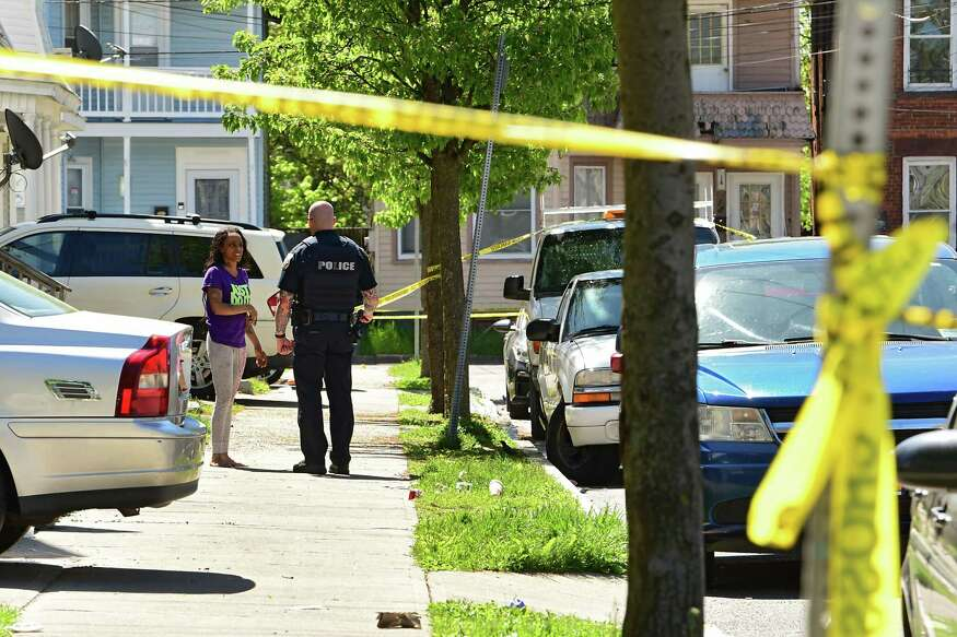 Police are seen at a scene where a man died in a late-night shooting Tuesday on Victory Avenue on Wednesday, May 20, 2020 in Schenectady, N.Y. (Lori Van Buren/Times Union)