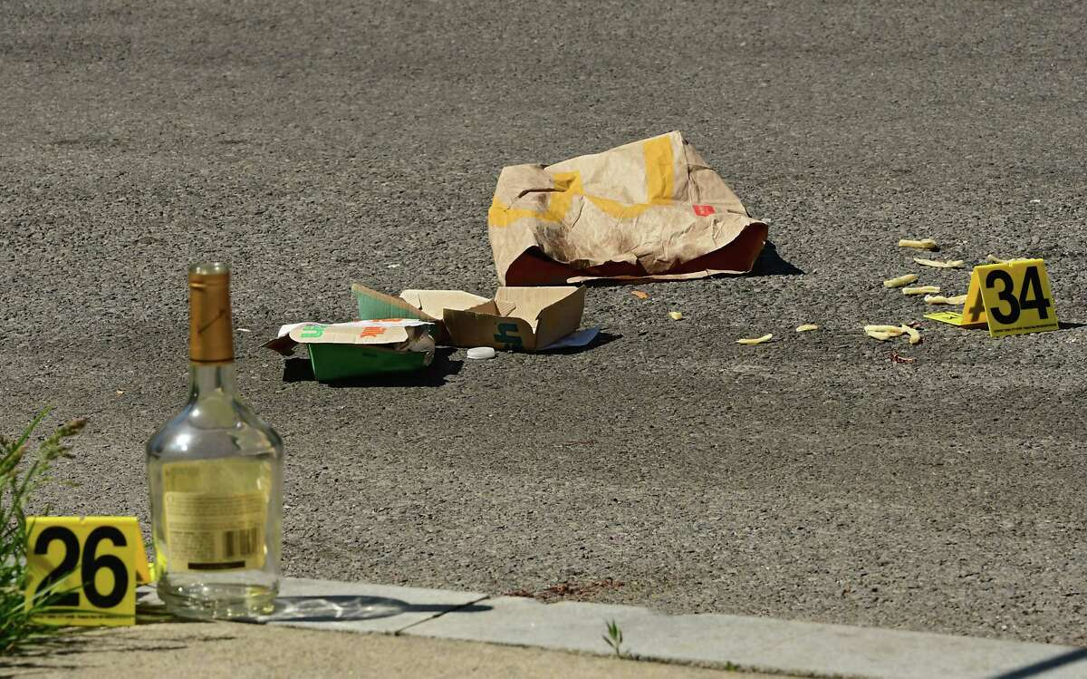Evidence markers are placed next to objects at a scene where Fred Gentry, 48, died in a late-night shooting Tuesday on Victory Avenue on Wednesday, May 20, 2020 in Schenectady, N.Y. (Lori Van Buren/Times Union)