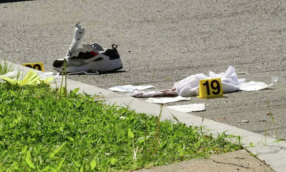 Evidence markers are placed next to objects at a scene where a man died in a late-night shooting Tuesday on Victory Avenue on Wednesday, May 20, 2020 in Schenectady, N.Y. A 28-year-old woman was wounded. (Lori Van Buren/Times Union)