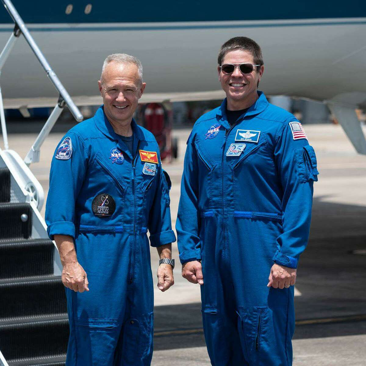 Astronauts Doug Hurley, left, and Bob Behnken at Ellington Airport on May 20, 2020. They are departing Houston for Kennedy Space Center in Florida, where they will launch into space on May 27 on a SpaceX Falcon 9 rocket and Crew Dragon spacecraft.