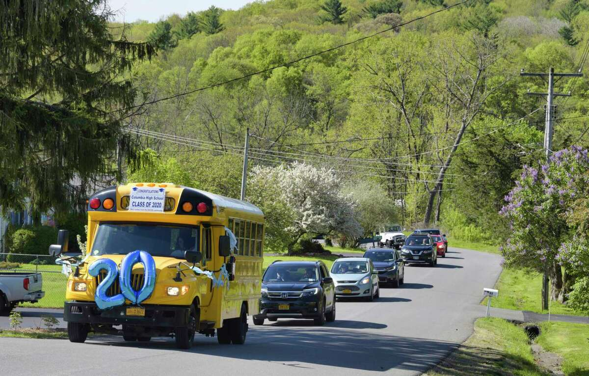 East Greenbush School District school bus driver, Carianne Rudolph leads a parade of cars filled with school teachers and staff on Wednesday, May 20, 2020, in East Schodack, N.Y. Bus drivers, teachers and staff were visiting every senior from Columbia High School over two days. This year 300 students will graduate from Columbia. (Paul Buckowski/Times Union)
