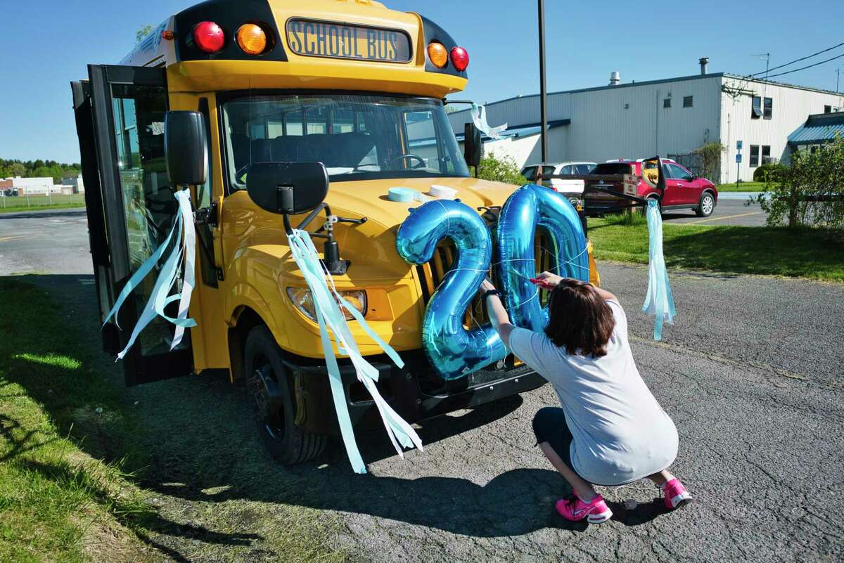 A study by researchers at the University of Texas at Austin predicts how many students may be infected with COVID-19 in the first week of school.  The results are based on overall infection rates in the county and are broken down by the size of the school.  East Greenbush School District school bus driver Carianne Rudolph decorates her bus which will lead a parade of cars filled with school teachers and staff on Wednesday, May 20, 2020, in East Greenbush, N.Y. (Paul Buckowski/Times Union)
