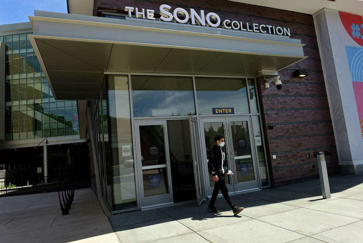 Local residents get out to enjoy the town Wednesday May 20, 2020, including patrons of the SoNo Collection mall during the limited reopeneing after the quarantine due to the coronavirus outbreak in Norwalk, Conn. Salons were asked not to reopen until June.
