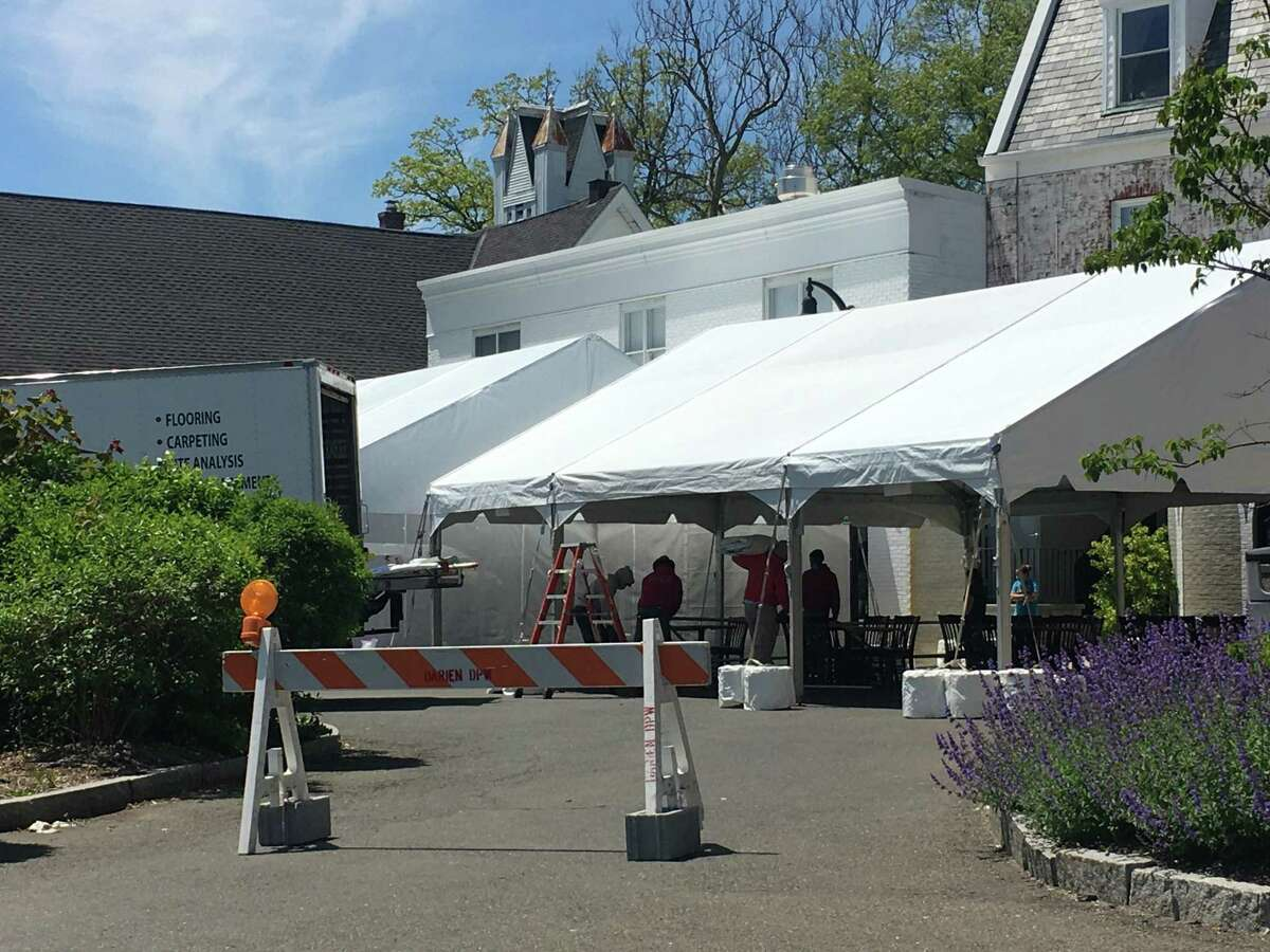 A tent set up behind The Goose, which is aiming to open at around 5 Wednesday.