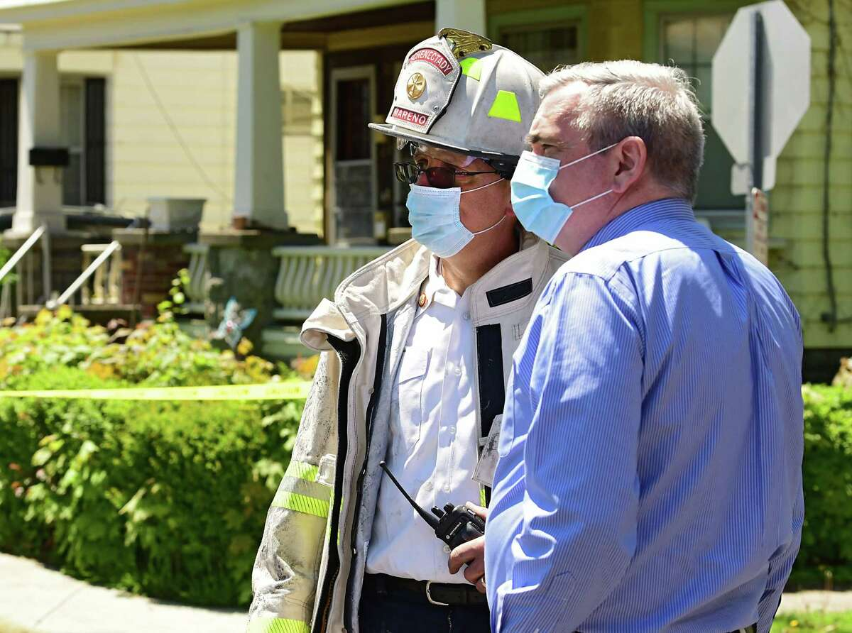 Mayor Gary McCarthy, right, talks to Assistant Fire Chief Don Mareno after a fatal fire on Elmer Ave. on Wednesday, May 20, 2020 in Schenectady, N.Y. (Lori Van Buren/Times Union)