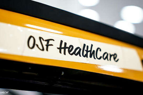 The team at Richard Childress Racing is honoring OSF HealthCare by putting the name above the door of Tyler Reddick's No. 8 Caterpillar Chevrolet.