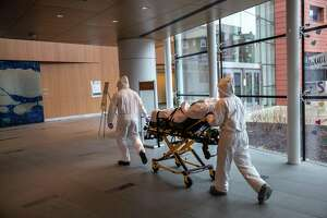 Medical staff transported a COVID-19 patient at Stamford Hospital last month.