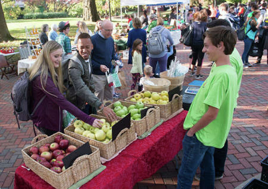 In this 2017 file photo, patrons visit the Land of Goshen Farmers' Market on the campus of Southern Illinois University Edwardsville.