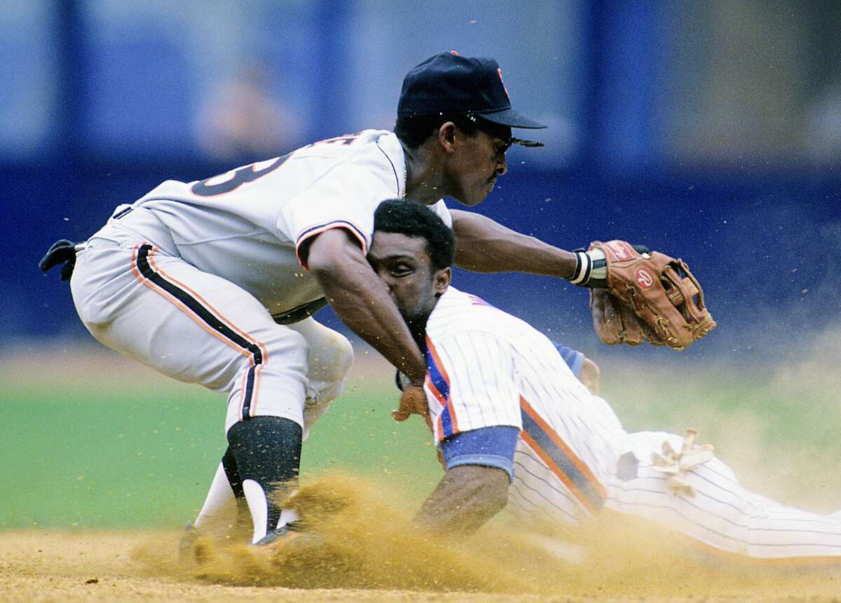 FLUSHING, NY - AUGUST 1988: Mookie Wilson #1 of the New York Mets slides into Jose Uribe #23 of the San Francisco Giants as he doubles in a game at Shea Stadium on August 28, 1988 in Flushing, New York. ~~
