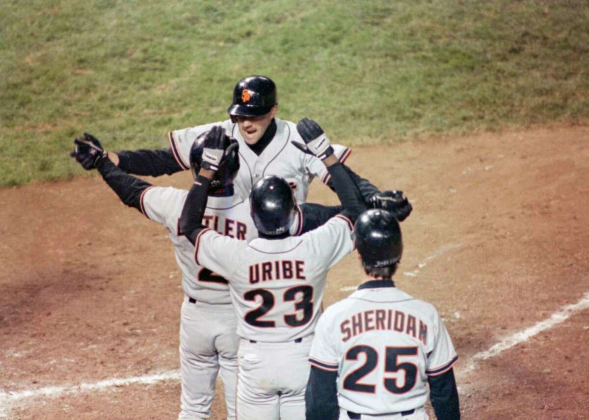 Jose Uribe (23) is among those greeting Will Clark after Clark's grand slam against the Cubs in the 1989 NLCS.