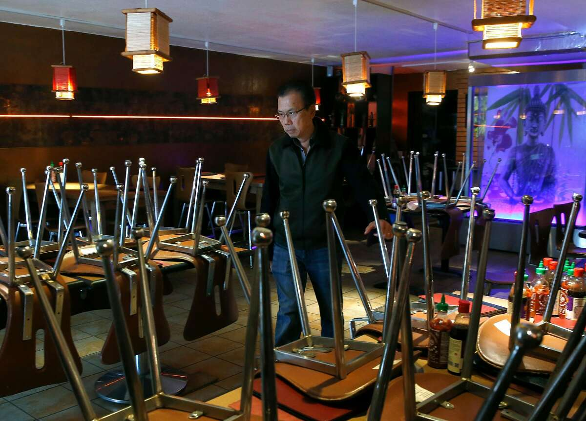 Green Papaya owner Thai Van walks through his temporarily closed restaurant at the Fifth and Mission garage in San Francisco, Calif. on Wednesday, May 20, 2020. Shuttered since shelter-in-place restrictions went into place, the Vietnamese restaurant depends heavily on walk-in business from convention attendees so its future is unknown because it's unclear when gatherings at Moscone Center will resume.