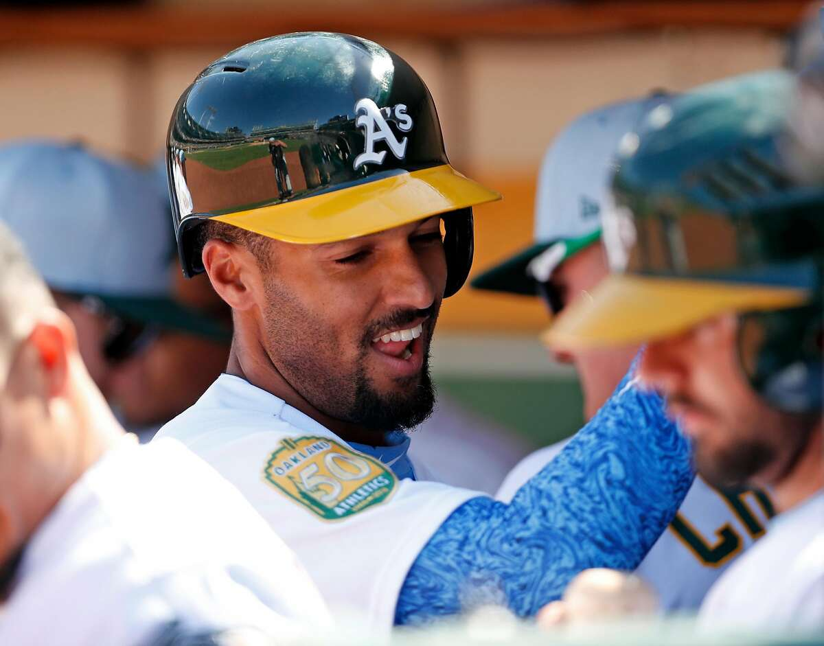 Oakland Athletics' Marcus Semien reacts to his home running 9th inning during A's 6-5 win over Los Angeles Angels in 11 innings at Oakland Coliseum in Oakland, Calif. on Sunday, June17, 2018.