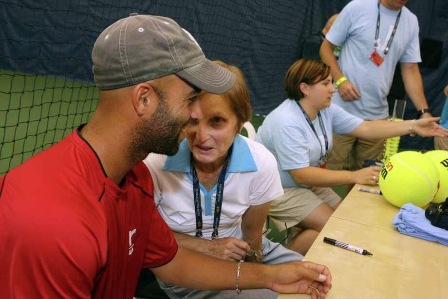 "James Blake and his mom, Betty, share a moment while signing her book,  ""Mix it Up, Make it Nice: Secrets of a tennis mom."",   during Pilot Pen Kids Day at the New Haven Tennis Center at Yale on Sunday, August 22, 2010. Photo: B.K. Angeletti / Connecticut Post"