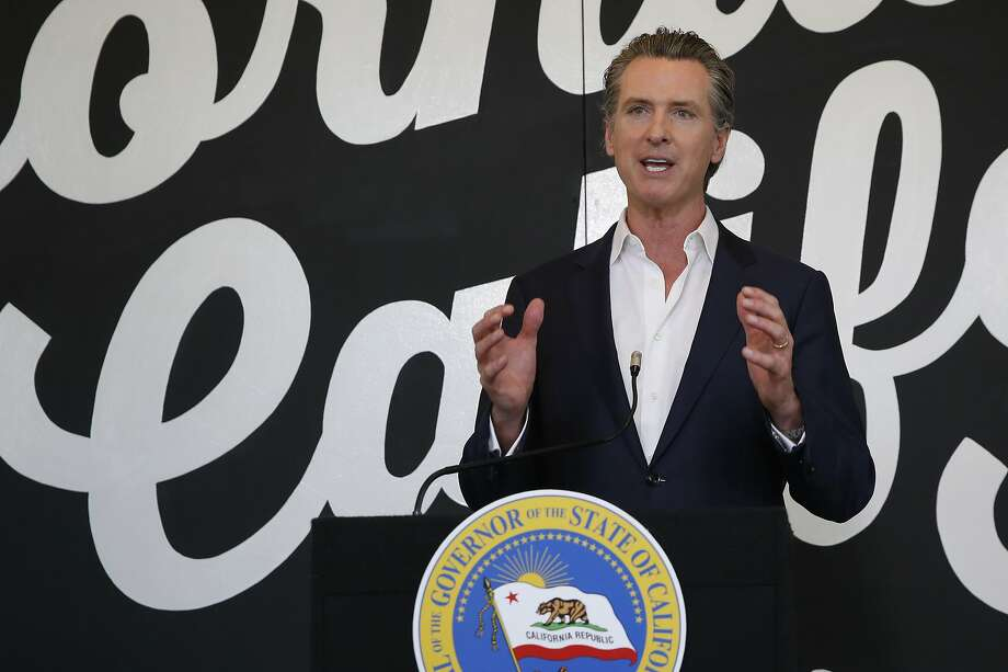 """FILE - In this May 5, 2020 file photo, California Gov. Gavin Newsom discusses his plan for the gradual reopening of California businesses during a news conference at the Display California store in Sacramento, Calif. While President Donald Trump claims mail-in voting is ripe for fraud and """"cheaters,"""" his reelection campaign and state allies are scrambling to launch operations meant to help their voters cast ballots in the mail. Newsom, a Democrat, has announced that the state's 20.6 million voters will be mailed ballots before Election Day. Photo: Rich Pedroncelli / Associated Press"""