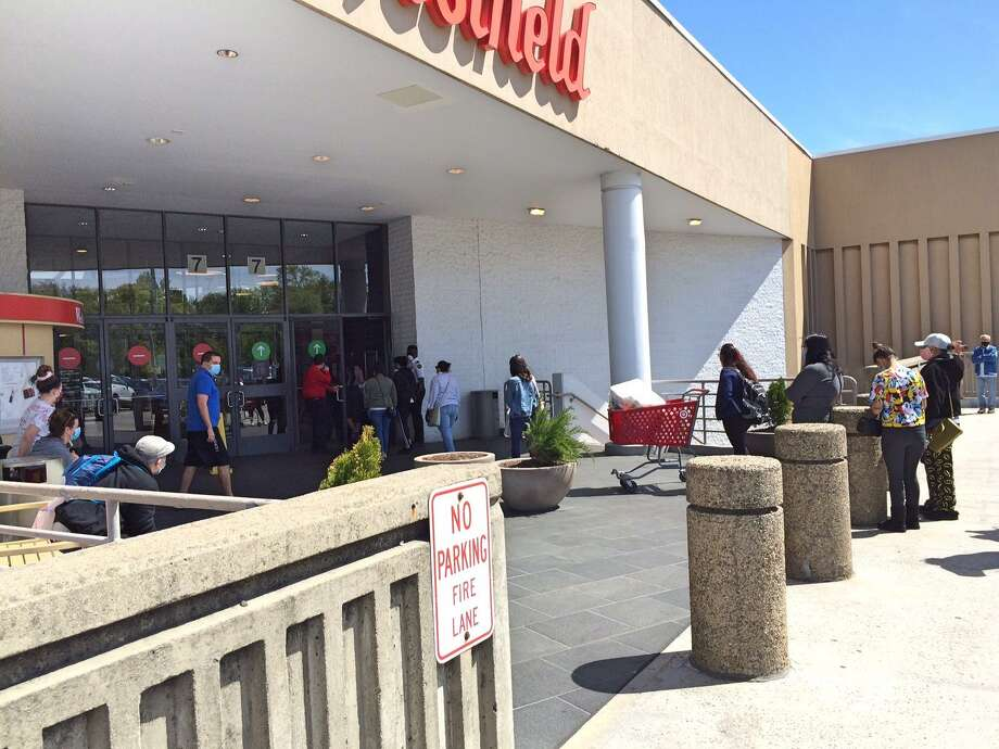 Shoppers wait outside Westfield Trumbull Mall prior to the shopping center's May 20 reopening. Photo: Donald Eng / Hearst Connecticut Media