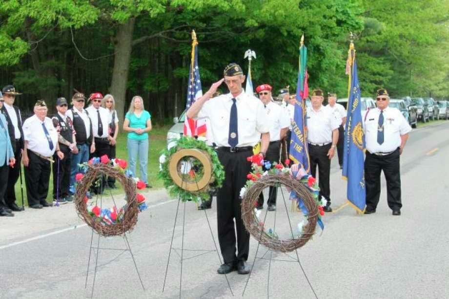 Veterans from American Legion Post No. 10 honor fallen soldiers during a Memorial Day ceremony, in this 2019 photo. This year, veteran's groups plan to hold private ceremonies during the pandemic. (File Photo)
