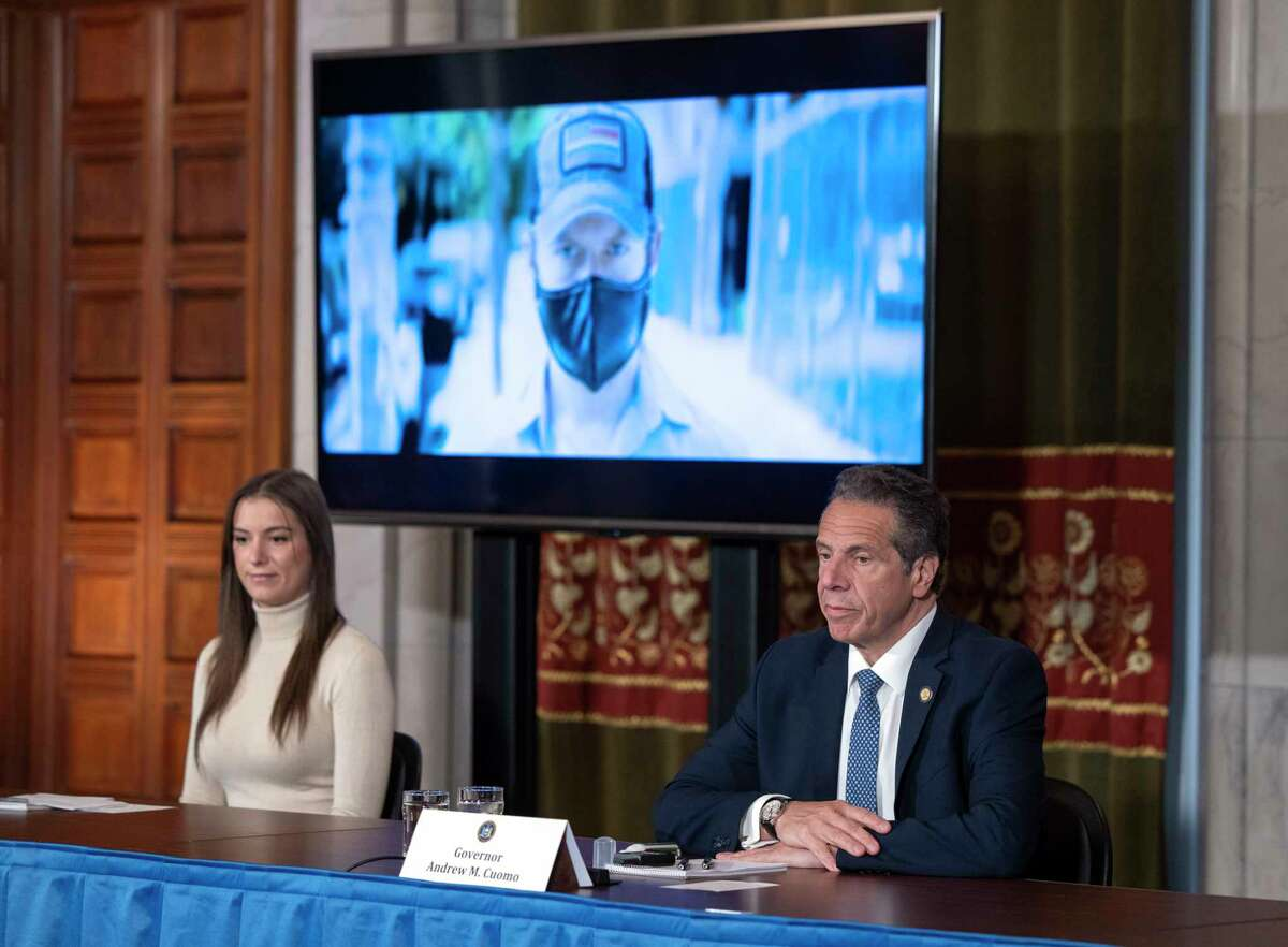 Gov. Andrew Cuomo is joined by his daughter, Mariah Kennedy Cuomo, left, during a coronavirus update press conference on Wednesday, May 20, 2020, in the Red Room at the Capitol in Albany, N.Y. (Office of the Governor)