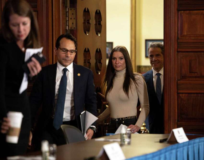 Gov. Andrew Cuomo, follows his daughter, Mariah Kennedy Cuomo, into the Red Room where he provided a coronavirus update during a press conference on Wednesday, May 20, 2020, in the Red Room at the Capitol in Albany, N.Y. (Office of the Governor)