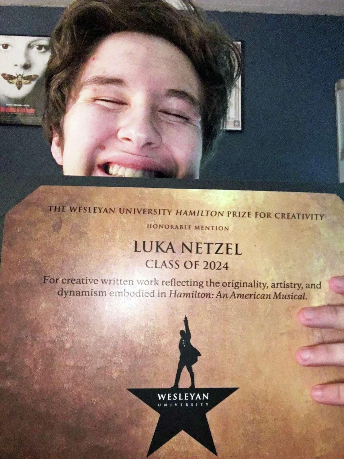 Wesleyan University student Luke Netzel shows off his Hamilton Prize for Creativity honorable mention.