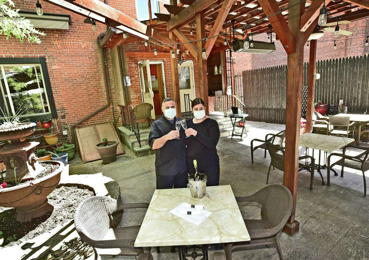 Chef Francesco d'Amuri, left, and his wife Alison DeRenzi, co-owners of L'Orcio restaurant in New Haven, are shown this spring when they reopened. The State Street restaurant will participate in Restaurant Week.
