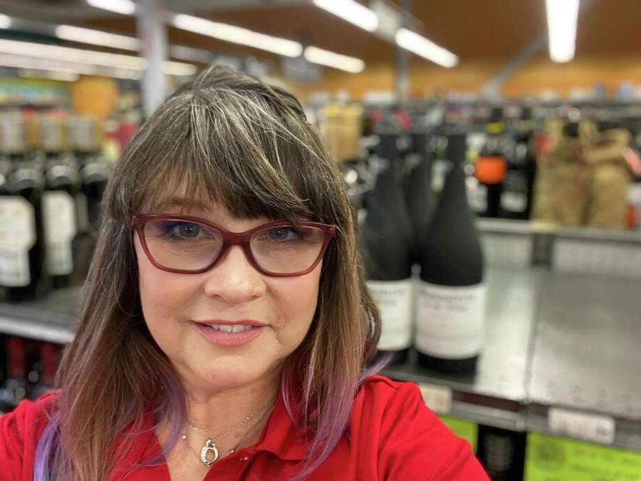 Since the COVID-19 pandemic, Katy resident Laura Crawley is a part-time cashier at Spec's after being on disability for years with her painful rheumatoid arthritis. She went back into the workforce with the help of Allsup Employment Services. Photo: Courtesy Of Laura Crawley