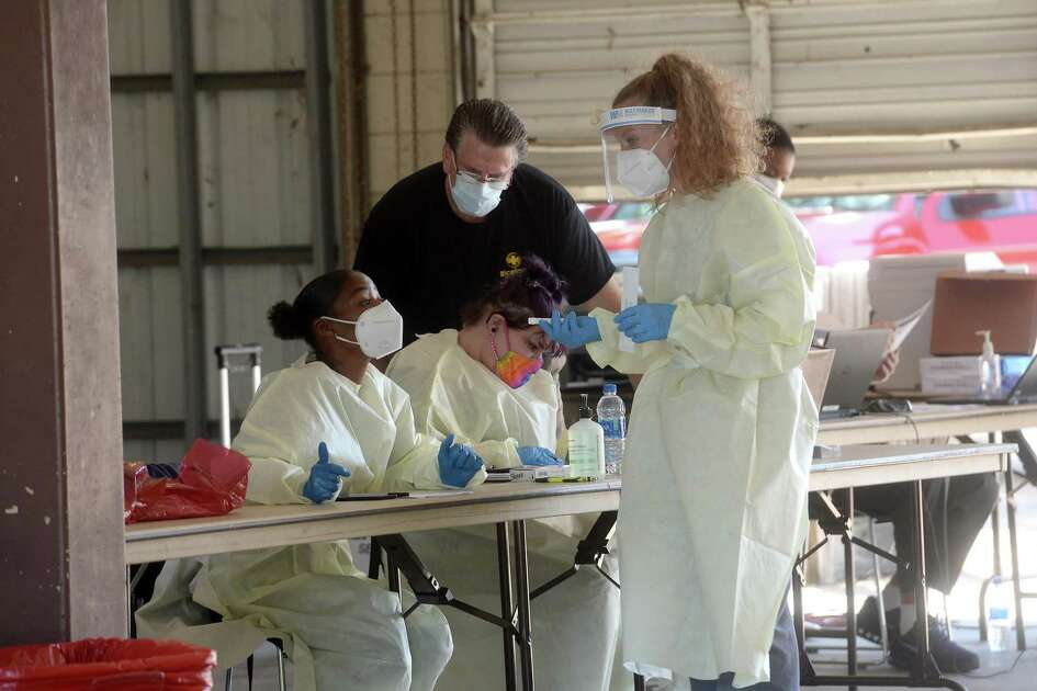 Healthcare workers with Riceland man a testing station at the former Beaumont Fire Station #1 Tuesday. Testing will continue at the site through Thursday. Appointments must be made, although there are no symptom requirements to obtain the test. Riceland will set up again in two weeks for another round of testing. Mayor Becky Ames encourages citizens to get tested and continue to practice safety measures, including wearing masks and observing social distancing. She also stronlgly enncourages those who have recovered to donate plasma, which contains antibodies that have proven useful in treating those fighting the virus. Photo taken Tuesday, May 19, 2020 Kim Brent/The Enterprise