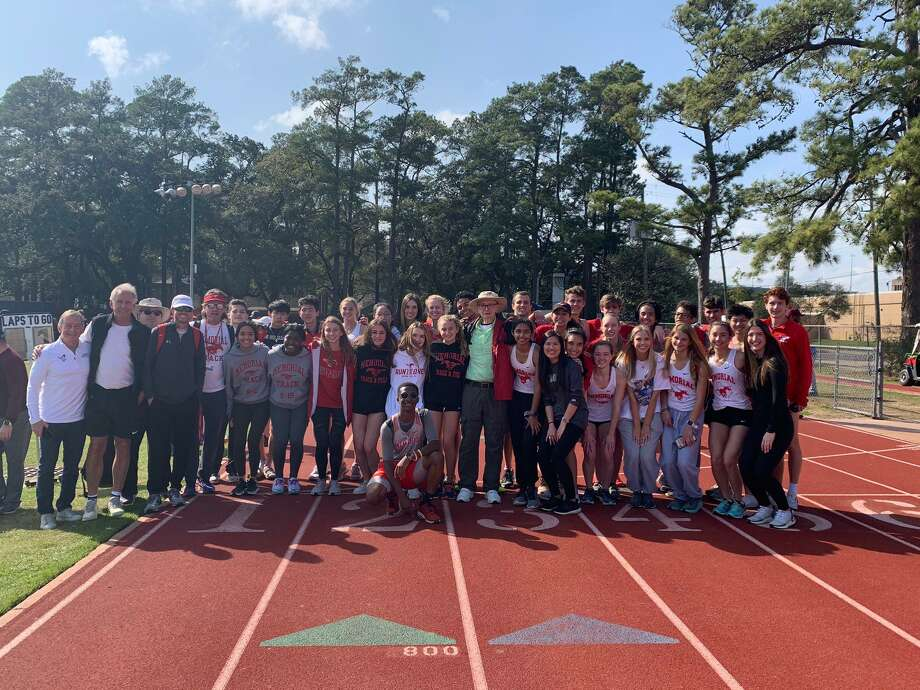 Members of the Memorial track and field teams, along with alumni, gather after the Will Taylor Relays in February. The Mustangs had 19 athletes honored in track and field on the THSCA all-state academic team. Photo: Memorial High School