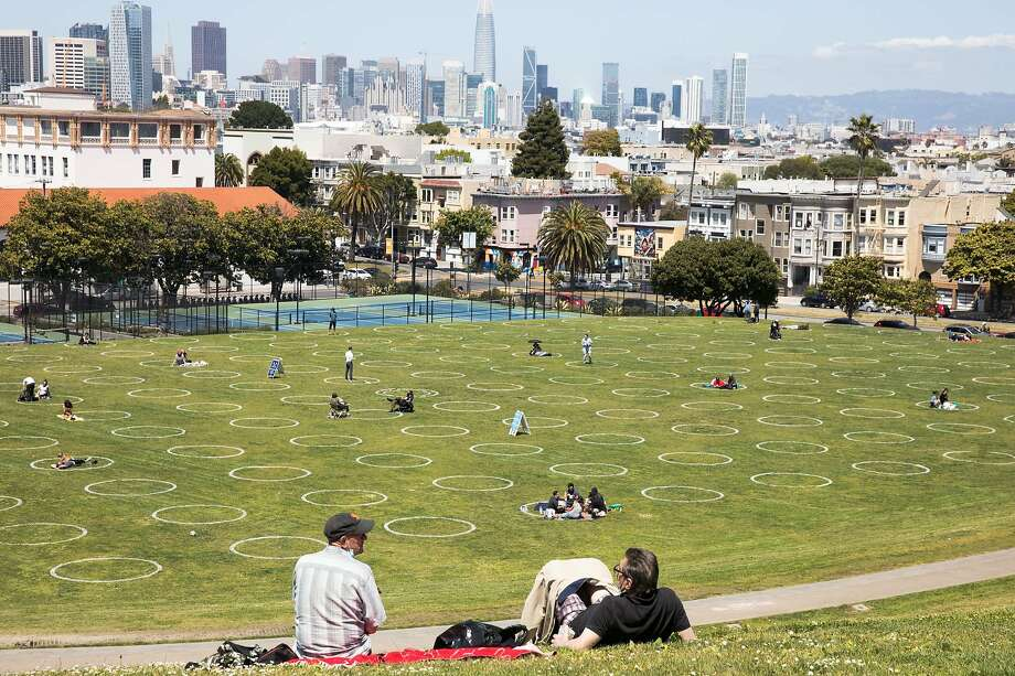 Groups gather inside social distancing chalk circles at Dolores Park. Photo: Douglas Zimmerman, SFGate