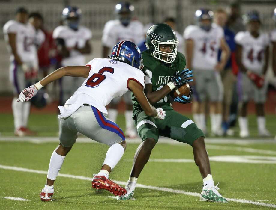 Strake Jesuit Crusaders wide receiver Bryce Palumbo (15) is tackled by West Brook Bruins defensive back Rylan Henson (6) in the second quarter of high school playoff football game on November 22, 2019 at Challenger Stadium in Waller, TX. Photo: Thomas B. Shea, Houston Chronicle / Contributor / © 2019 Thomas B. Shea / Houston Chronicle / Contributor