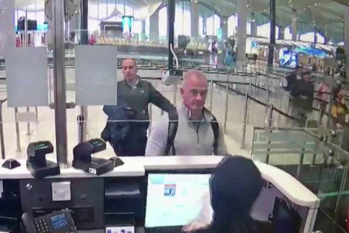 This Dec. 30, 2019 image from security camera video shows Michael L. Taylor, center, and George-Antoine Zayek at passport control at Istanbul Airport in Turkey. Taylor, a former Green Beret and his son, Peter Taylor, 27, were arrested Wednesday, May 20, 2020 in Massachusetts on charges they smuggled Nissan Motor Co. Chairman Carlos Ghosn out of Japan in a box in December 2019, while he awaited trial there on financial misconduct charges. (DHA via AP)
