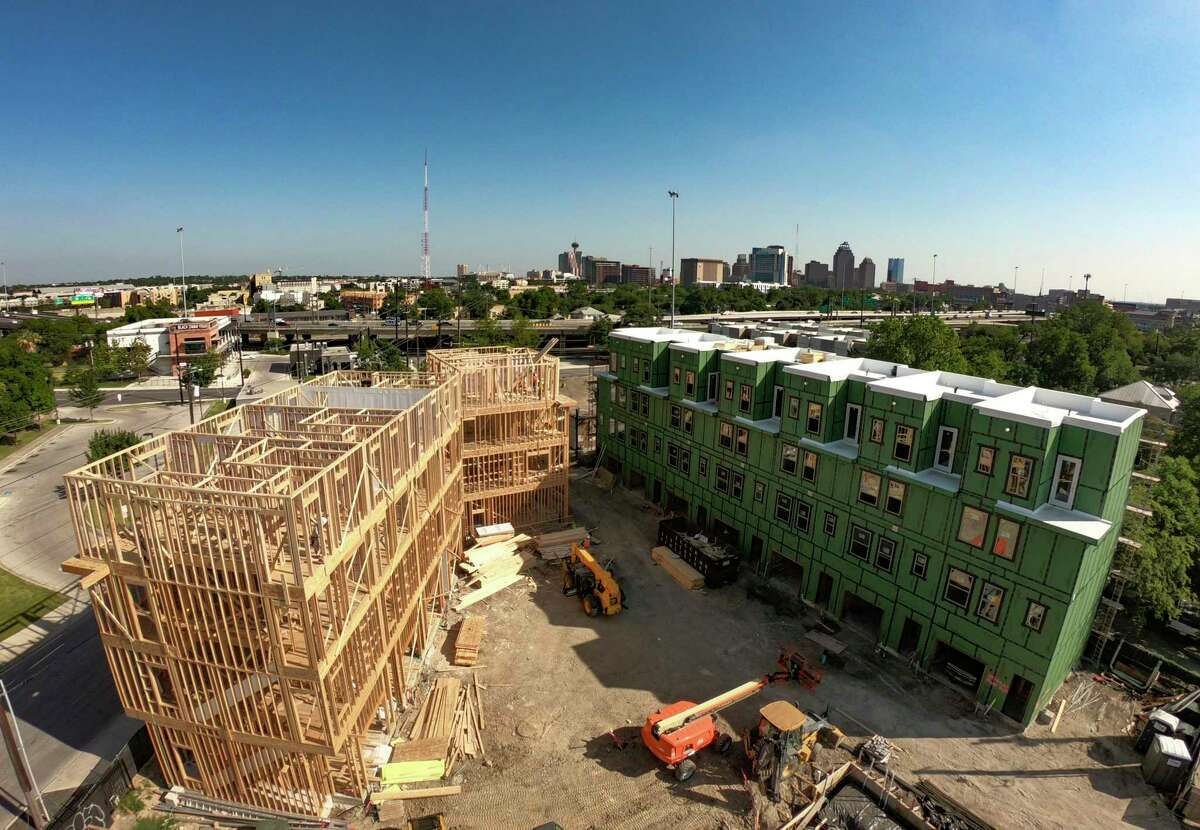 """""""The Legacy"""" condominiums, at the intersection of St. Mary's and Euclid near downtown, are part of the wave of new housing to accommodate the city's booming population."""