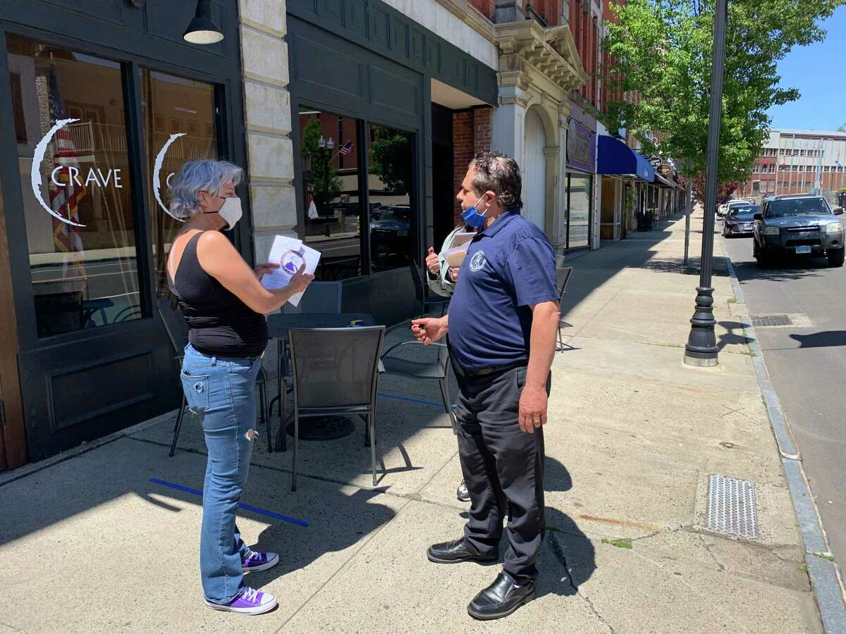 Ansonia Mayor David Cassetti discusses the re-opening outside dining guidelines with Libby Meissner, owner of Crave, a Latin Fusion restaurant on Main Street.