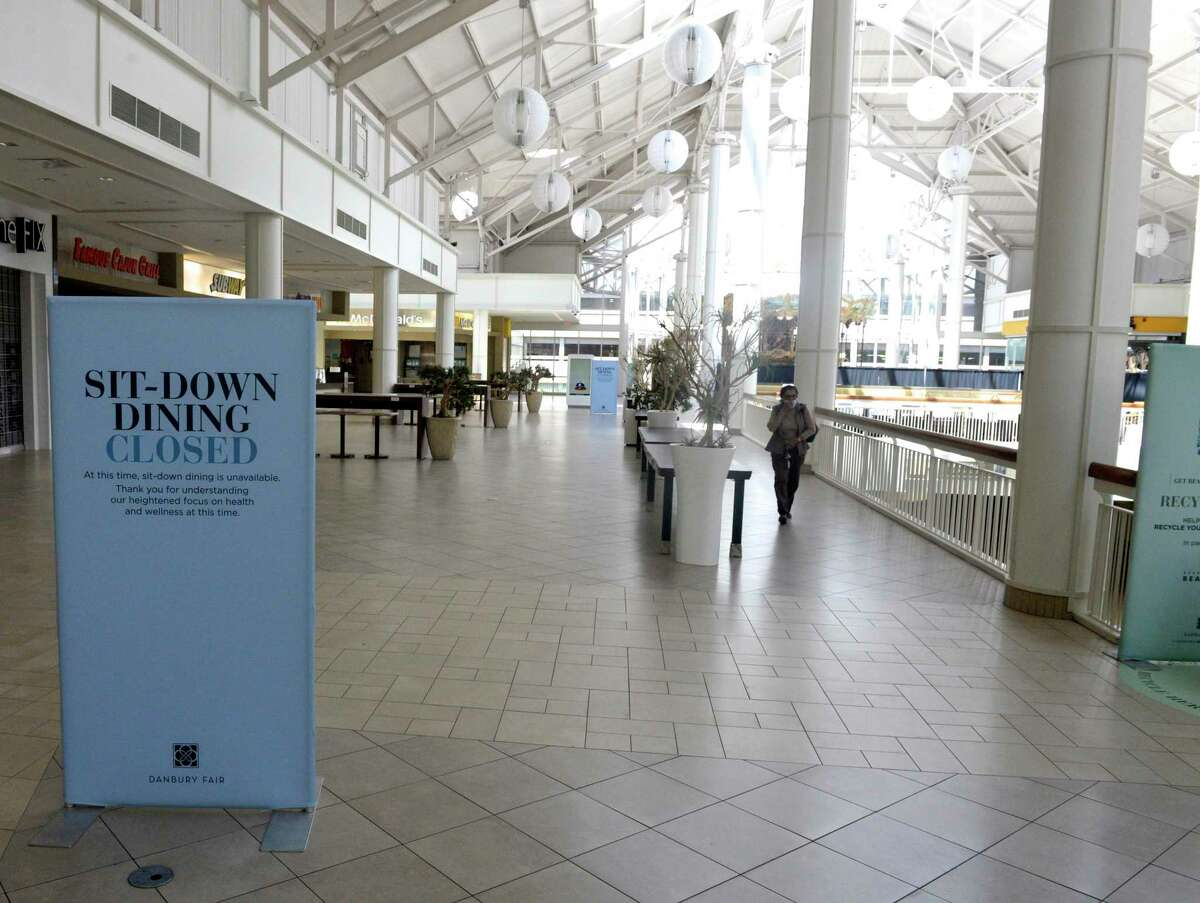 File photo from signage posted around the Danbury Fair mall on the first day of Phase 1 reopening of businesses across the state. Wednesday, May 20, 2020, in Danbury, Conn.