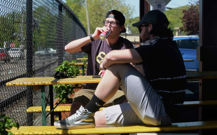 Peter Carpenter and Ryan Grady, both of Naugatuck, had lunch at Broken Symmetry Gastro Brewpub in Bethel. The brewpub offered outdoor sit-down dining on Wednesday under Phase 1 of Connecticut's reopening plan.