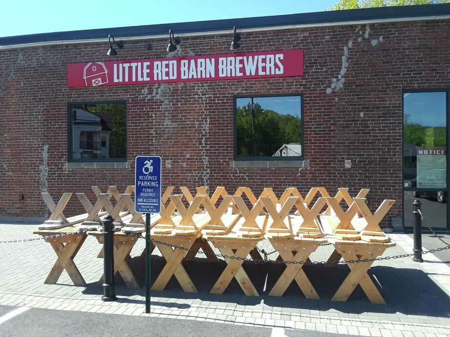 Restaurants were allowed to open Wednesday for outside dining. Little Red Barn Brewers are preparing for Memorial Day weekend, when the patio will be open. Above, a stack of picnic tables are ready to go. Photo: Emily M. Olson / Hearst Connecticut Media /
