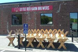 Restaurants were allowed to open Wednesday for outside dining. Little Red Barn Brewers are preparing for Memorial Day weekend, when the patio will be open. Above, a stack of picnic tables are ready to go.