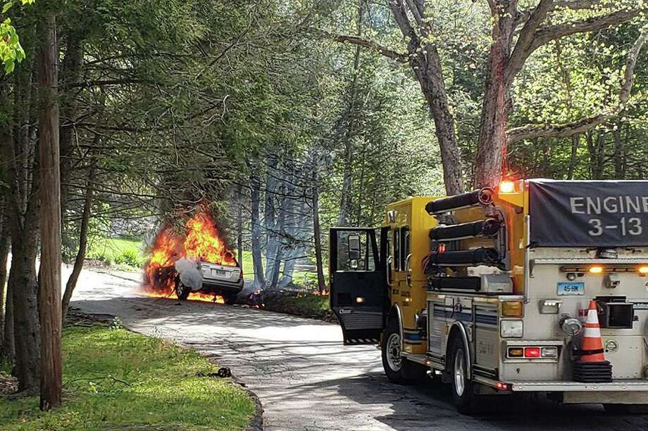 Units from the Haddam Volunteer Fire Company were first dispatched at 10:05 a.m. for a reported car that had crashed into a tree on Ponsett Road. Officials said the first arriving crews found a fully-involved vehicle fire. Photo: Contributed Photo / Kevin McManus