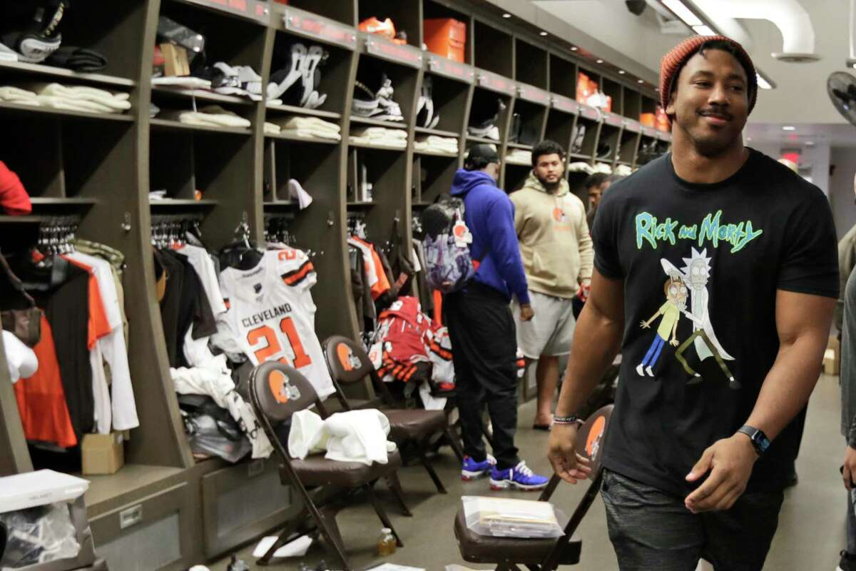 FILE - In this Dec. 30, 2019, file photo, Cleveland Browns defensive end Myles Garrett walks through the locker room at the NFL football team's training camp facility in Berea, Ohio. The NFL is taking baby steps toward full reopenings for its teams. It has no other choice. Consider social distancing. This could be the most difficult task of all. (AP Photo/Tony Dejak, File)