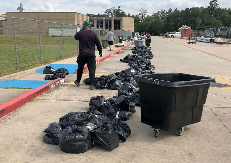 Kingwood Park coaches wait for student athletets to pickup equipment . Photo: Contributed Photo