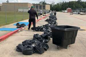 Kingwood Park coaches wait for student athletets to pickup equipment .