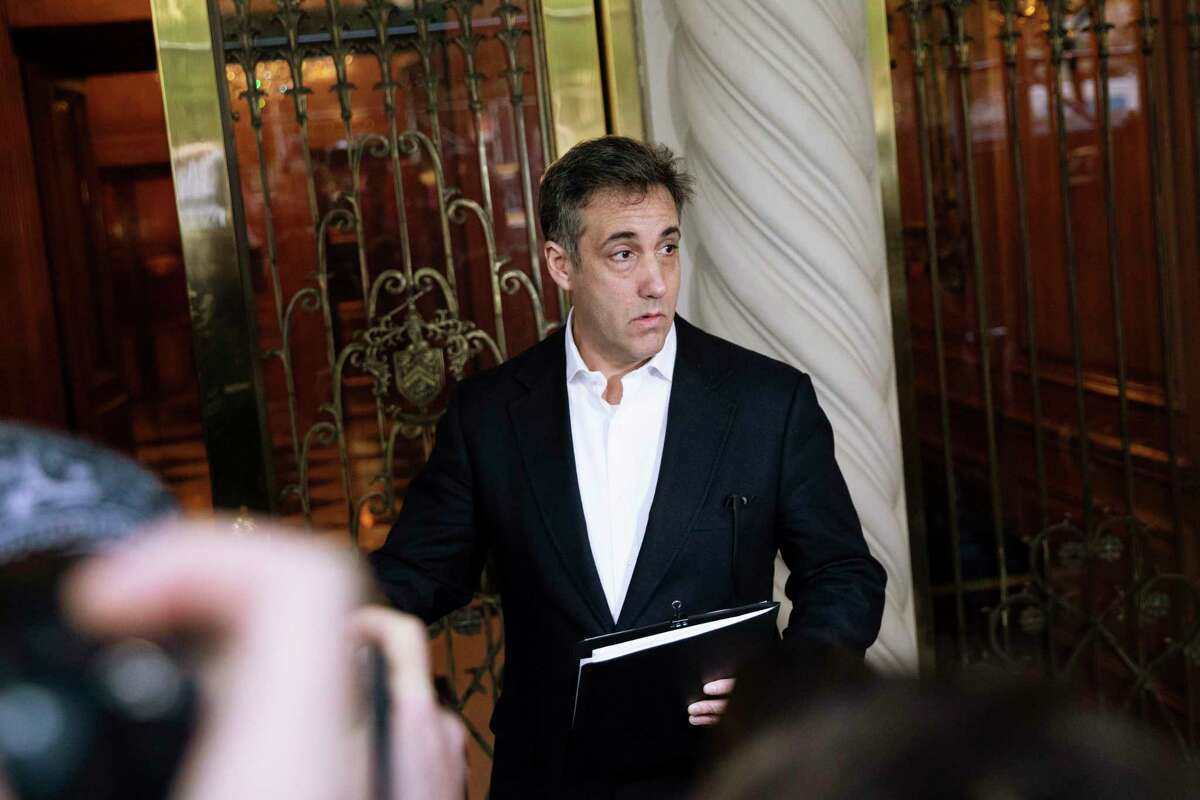 FILE - In this May 6, 2019, file photo Michael Cohen, former attorney to President Donald Trump, holds a press conference outside his apartment building before departing to begin his prison term in New York. Cohen will be released from federal prison on Thursday, May 21, 2020, and is expected to serve the remainder of his sentence at home, a person familiar with the matter told The Associated Press. (AP Photo/Kevin Hagen, File)