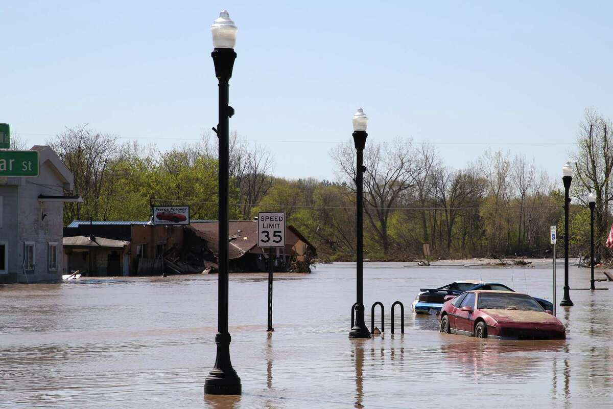 SANFORD, MICHIGAN - MAY 20: Main street is flooded after water from the Tittabawassee River breached a nearby dam on May 20, 2020 in Sanford, Michigan. Thousands of residents have been ordered to evacuate after two dams in Sanford and Edenville collapsed causing water from the Tittabawassee River to flood nearby communities. (Photo by Gregory Shamus/Getty Images)