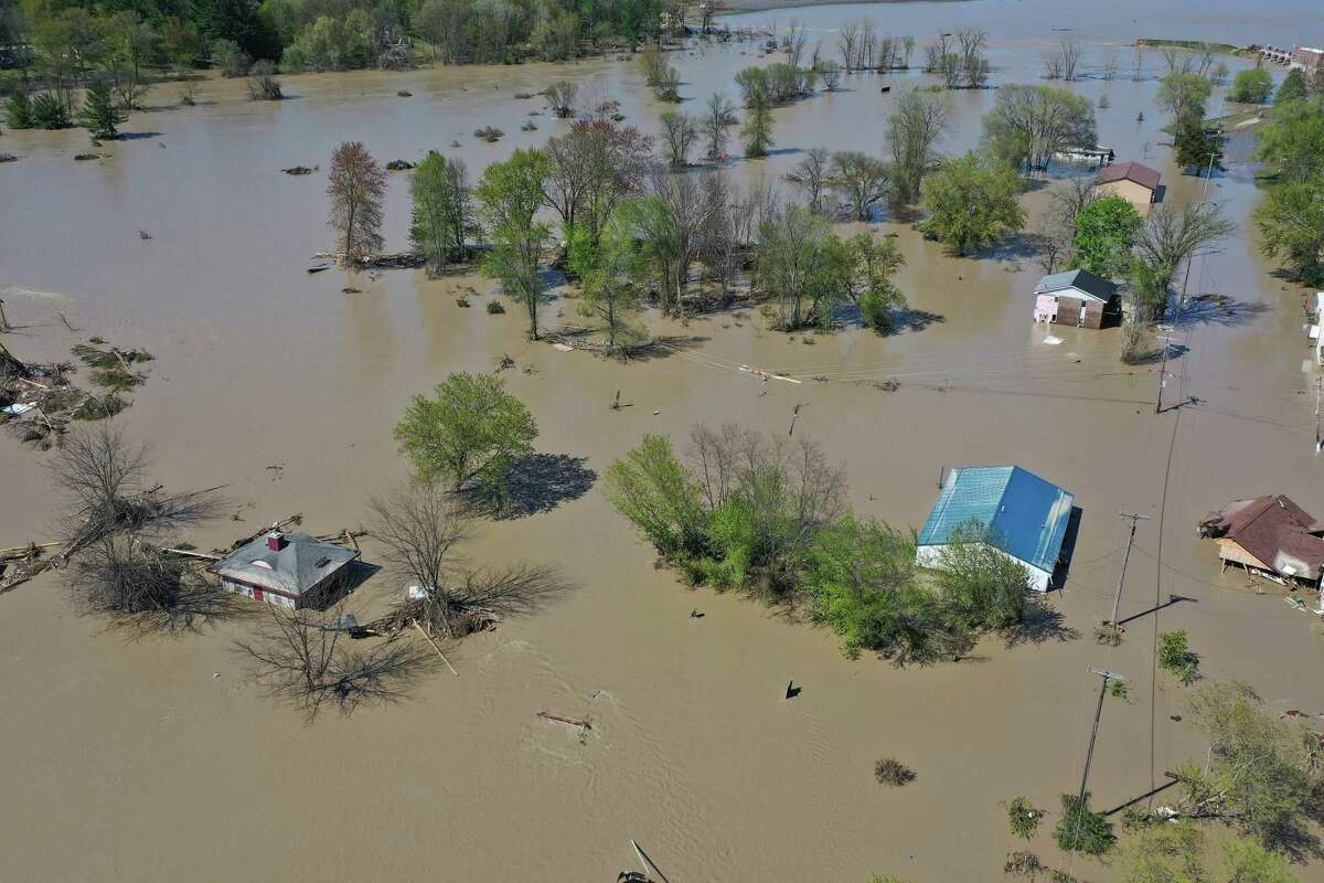 SANFORD, MICHIGAN - MAY 20: Aerial view of the Tittabawassee River after it breached a nearby dam on May 20, 2020 in Sanford, Michigan. Thousands of residents have been ordered to evacuate after two dams in Sanford and Edenville collapsed causing water from the Tittabawassee River to flood nearby communities. (Photo by Gregory Shamus/Getty Images)
