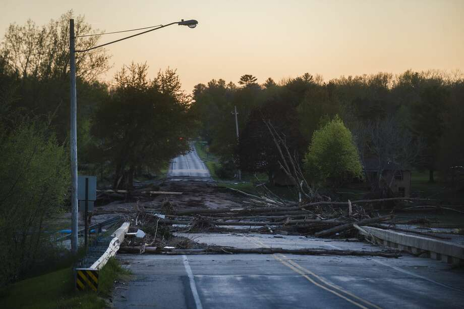 The sun sets over the West Curtis Road Bridge Wednesday evening, May 20, 2020, after it was destroyed by floodwater due to the failure of the Edenville Dam. (Katy Kildee/kkildee@mdn.net) Photo: (Katy Kildee/kkildee@mdn.net)