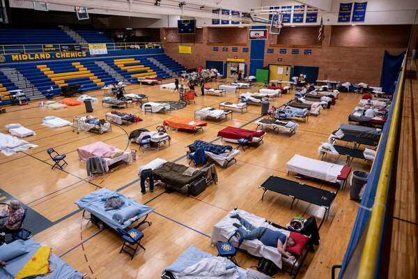 Midland residents take refuge at a temporary shelter at Midland High School during the city's largest flood in history Wednesday, May 20, 2020. Volunteers dropped of a plethora of supplies for those in need. (Adam Ferman/for the Daily News)