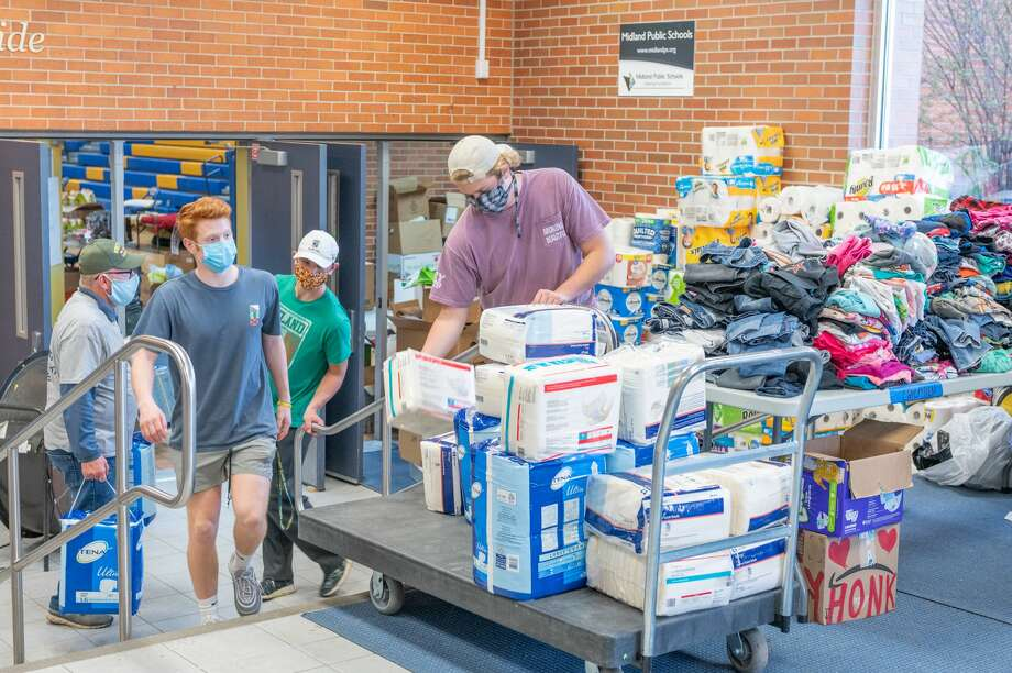 Midland residents take refuge at a temporary shelter at Midland High School during the city's largest flood in history Wednesday, May 20, 2020. Volunteers dropped of a plethora of supplies for those in need. (Adam Ferman/for the Daily News) Photo: (Adam Ferman/for The Daily News)