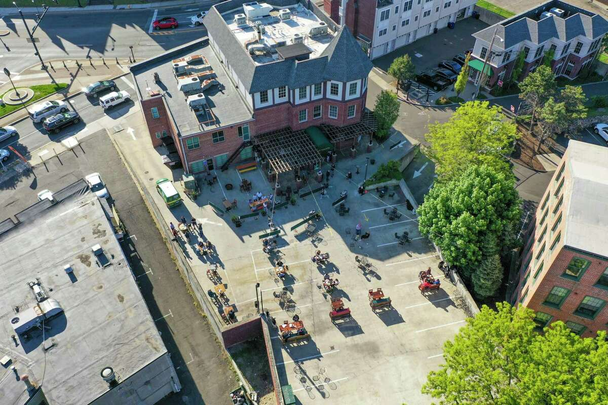 The view from above Washington Street in South Norwalk Wednesday evening as restaurants opened for outdoor dining. O'Neill's Irish Pub & Restaurant converted its parking lot into an outdoor seating area.