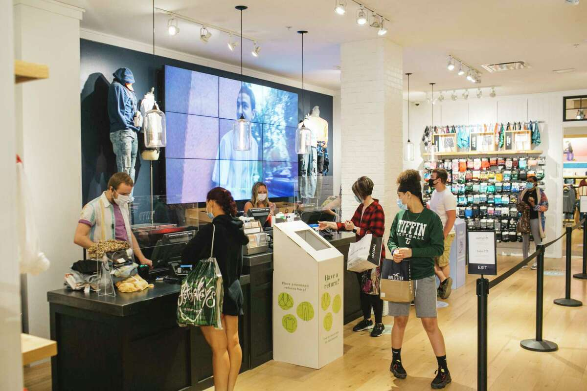 Customers pay through a plexiglass divider at American Eagle Outfitters at Easton Town Center in Columbus, Ohio.